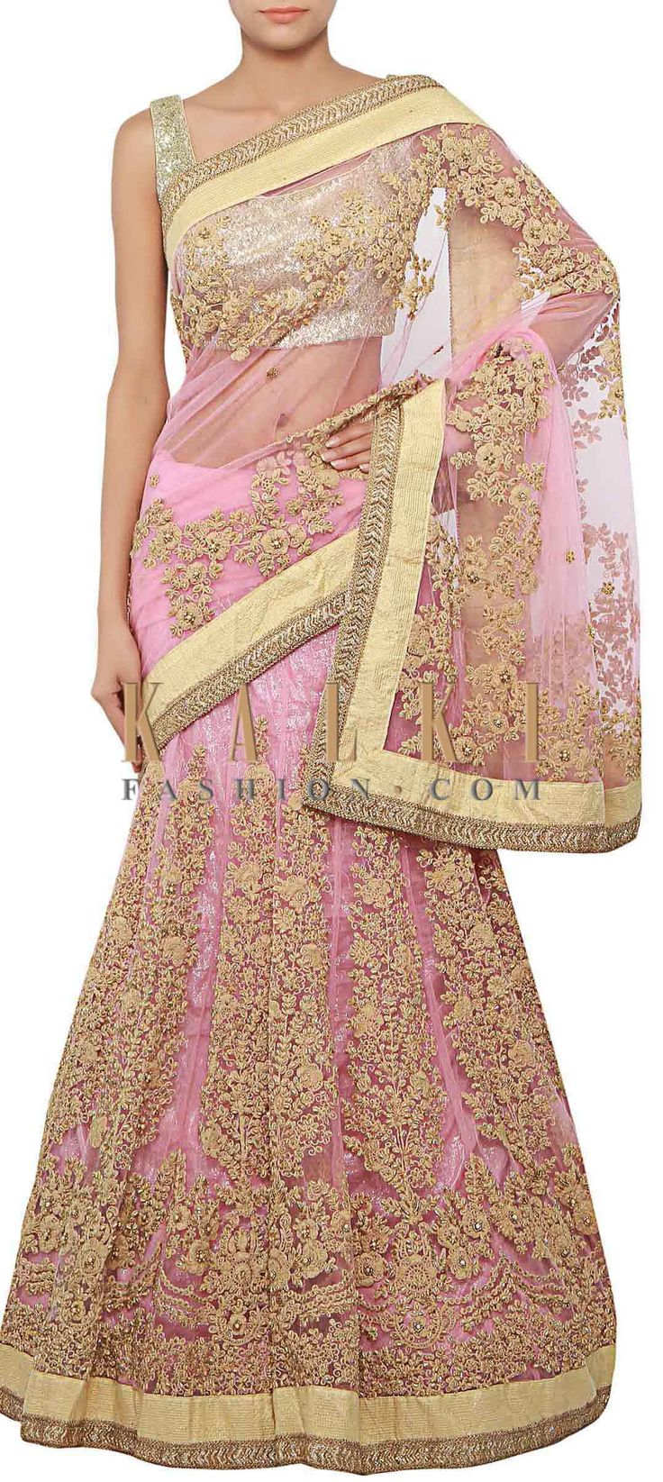 Buy Online from the link below. We ship worldwide (Free Shipping over US$100) http://www.kalkifashion.com/pink-lehenga-saree-adorn-in-thread-and-pearl-embroidery-only-on-kalki.html