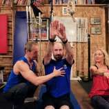 Jerzy Gregorek (left) and Aniela Gregorek (right) work with Michael Snyder (center), chair of the genetics department at Stanford University, during a mini workout in the gym at their home on Tuesday, January 2, 2018 in Woodside.