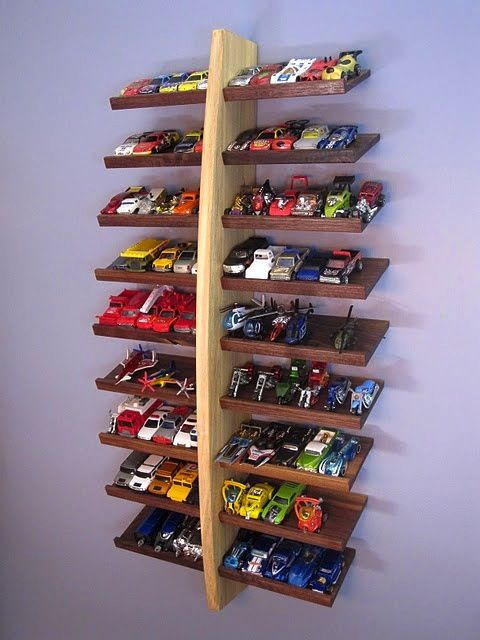 Slanted shelf for cars - Get Organized in 2013 - Kids Bedroom and Play Room Organization Tips and Ideas (photo from BHG.com)