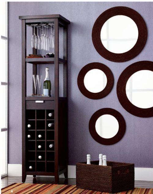 Decoraci n interiores espejos redondos en las paredes for Comedores circulares modernos