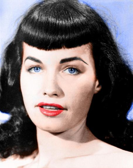 red lips were part of her signature look as well as her blue eyes and black hair with short bangs. women still wear this look today. even celebrities such as katy perry