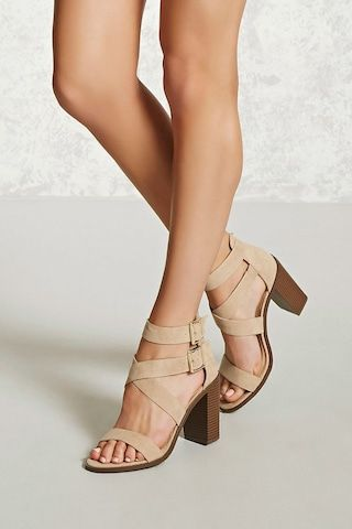 A pair of faux suede sandals featuring a strappy design, a dual buckle ankle closure, and a stacked block heel.