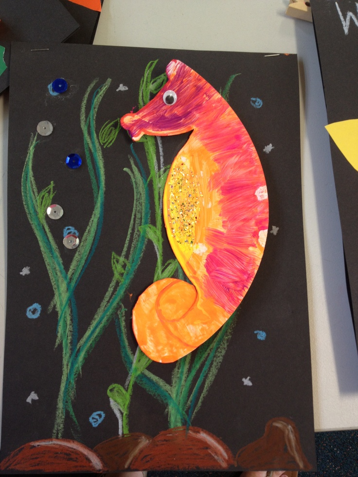 Paper plate seahorse on black card and chalk...