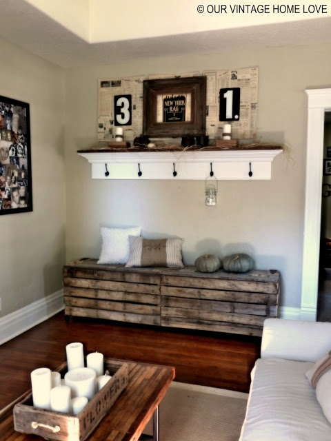 Our Vintage Home Love: Rustic Pallet Bench. I love the candles on the coffee table, also the 3 and 1 pictures made me think about copying the front of the newspaper articles from the day the boys were born and using them as mats to frame their new born pictures. how vintage. LOVE!