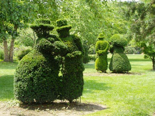 A topiary version of the Georges Seurat painting Sunday Afternoon on the Isle of La Grand Jatte at the Topiary Park in Columbus, OH.