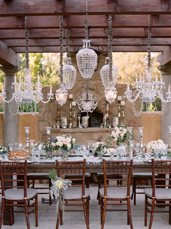 chandeliers, chiavari chairs, long dramatic table, white and crystal accents