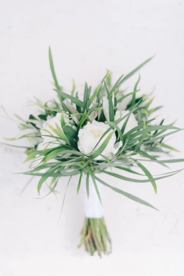 Peony and greenery wedding bouquet: http://www.stylemepretty.com/2017/03/15/santorini-modern-minimalist-wedding/ Photography: Ben Yew - https://benyew.com/
