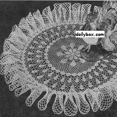 Free crochet ruffled centerpiece doily pattern at doilybox.com