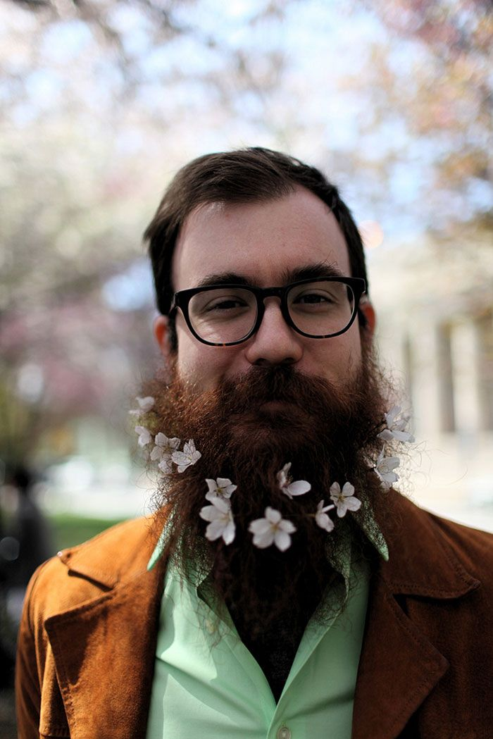 Do you remember Pierce Thiot, a photographer who has a thing for putting various objects into his beard? Apparently, he's not the only one into this! Now, men around the world are putting beautiful arrangements of flowers into their beards.