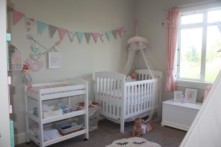 Homemade bunting & change table cover. Kmart mat. Ikea hacked bed canopy.
