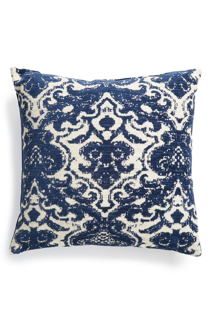 With a richblue pattern on one side and a velvet material on the reverse, this versatile accent pillow will add texture and depth to any room in the home.