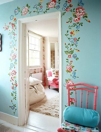 Applied Floral Decals around door frame - I would do this and be even more likely to do it along a long hallway with multiple doors.