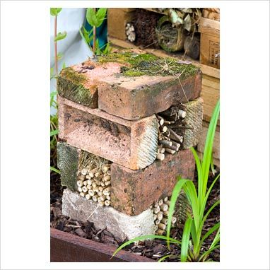 Bug hotel made from bricks and bamboo