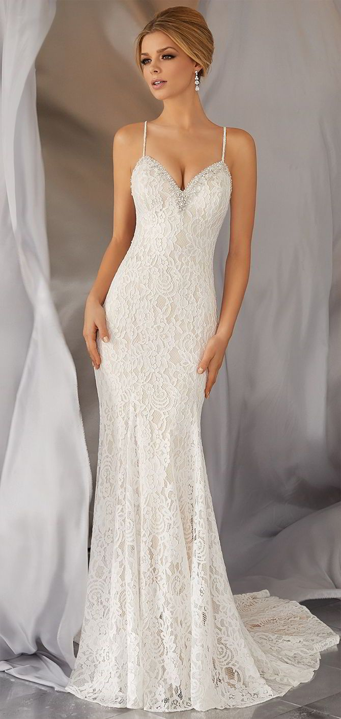 Fun and Flirty, this Allover Alençon Lace, Slim Wedding Dress Features a Diamanté and Crystal Beaded Neckline and Back Strap Detail.