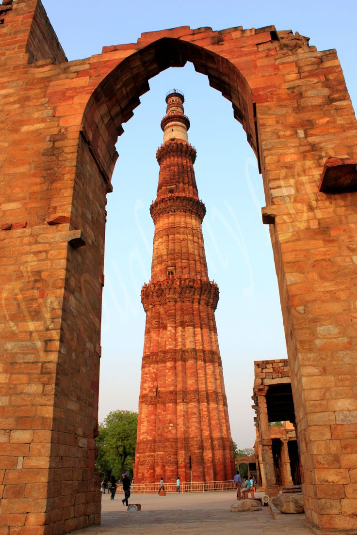 Qutub Minar is made up of red and buff sandstone, containing intricate carvings and verses from the Holy Quran.