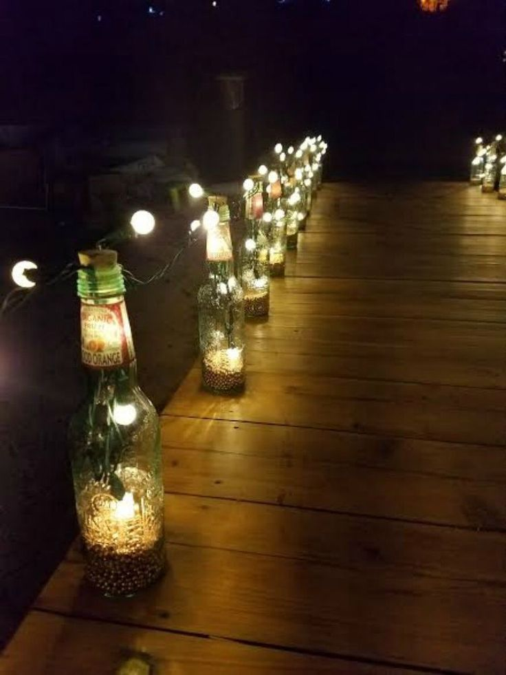 s reuse empty glass bottles for these 14 gorgeous decor ideas, home decor, Line them up as gorgeous pathway lights