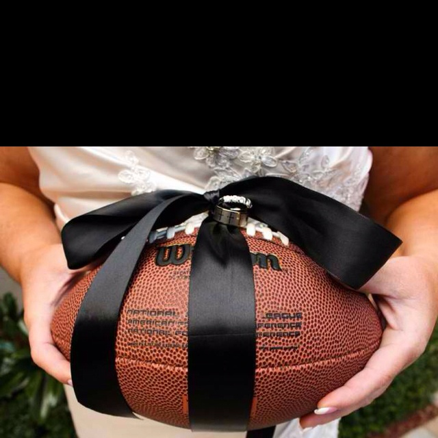 "the ring bearer's ""pillow"",.. i thought that this was a really really good idea for people who both enjoy football."