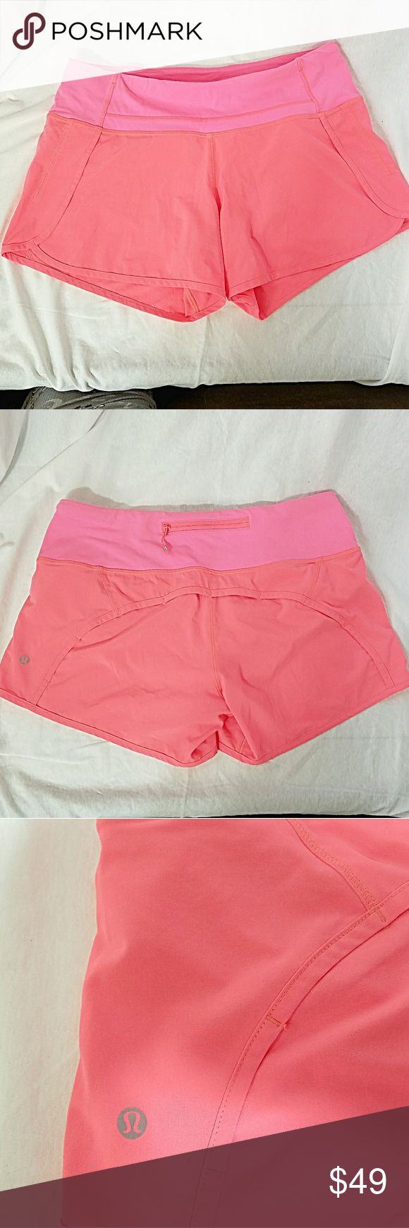 "LULULEMON *nwot Sz6 Neon Coral Pink Running Shorts Brand: Lululemon Athletica  Item: * Neon Coral Pink Running Shorts * There are 2 Small Pockets at the Waist for a Key, Cash, etc *1 Zippered Small Pocket on the Back of the Shorts - this is Where the Size Circle is Located *Waist Measures 15.5"" Flat *NWOT, New Without Tags  *no trades, offers via offer button only* lululemon athletica Shorts"