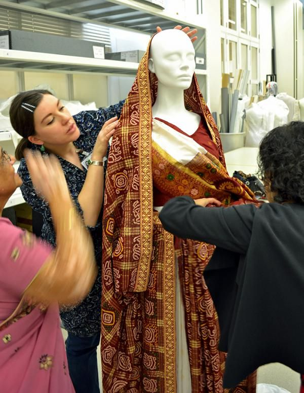 The red sari, given by the grooms' family is worn looped over the brides' head ©Victoria and Albert Museum, London