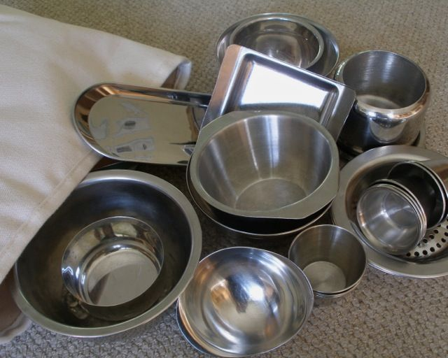 stainless steel bowls in a rectangular shelf storage bag