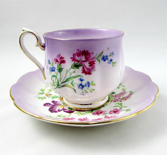 Made by Royal Albert, tea cup and saucer are purple with large flowers. Gold trimming on cup and saucer edges. Cup is in the Hampton shape. Excellent condition (see photos). Markings read: Royal Albert Bone China England Please bear in mind that these are vintage items and there