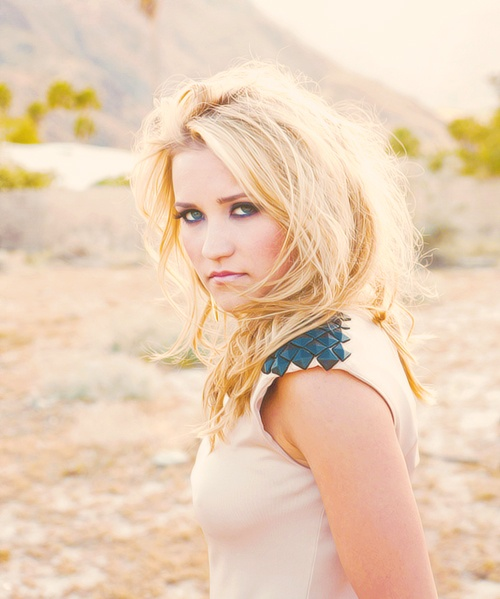 Emily Osment looks very sultry in this pose.