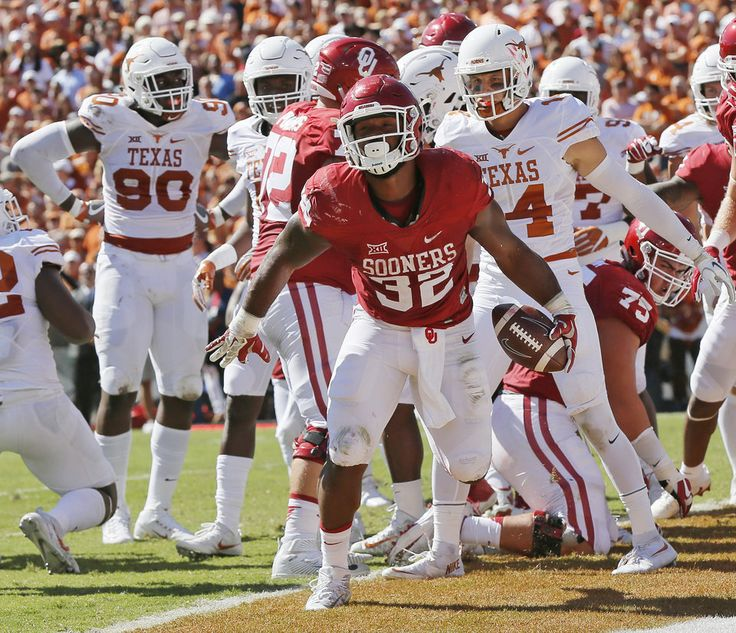 Oklahoma's Samaje Perine (32) reacts after scoring a touchdown in the first quarter during the Red River Showdown college football game between the University of Oklahoma Sooners (OU) and the Texas Longhorns (UT) at Cotton Bowl Stadium in Dallas, Saturday, Oct. 8, 2016. Photo by Nate Billings, The Oklahoman