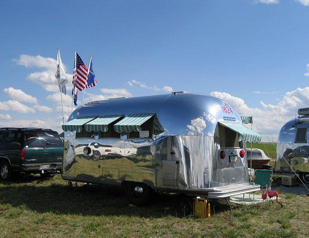 LOVE the vintage-looking awnings on these vintage Airstreams:)