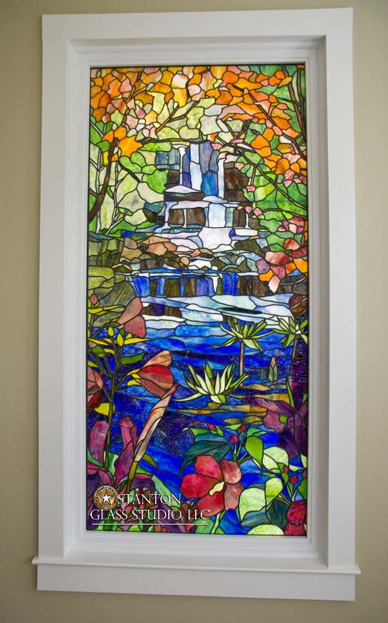 This custom stained glass waterfall adds color and light to the home. Check out our website for information on ordering a similar custom element for your own home. Design by Stanton Studios.