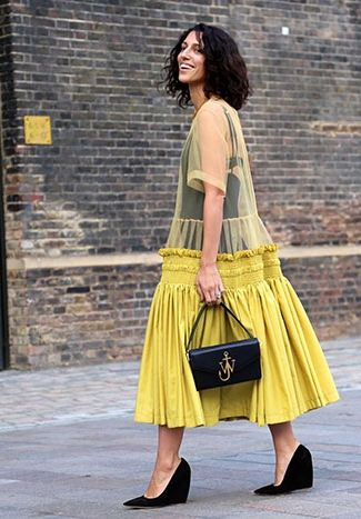 London street snap: Yasmin Sewell in a stunning, sheer yellow dress, styled with contrasting black accessories.