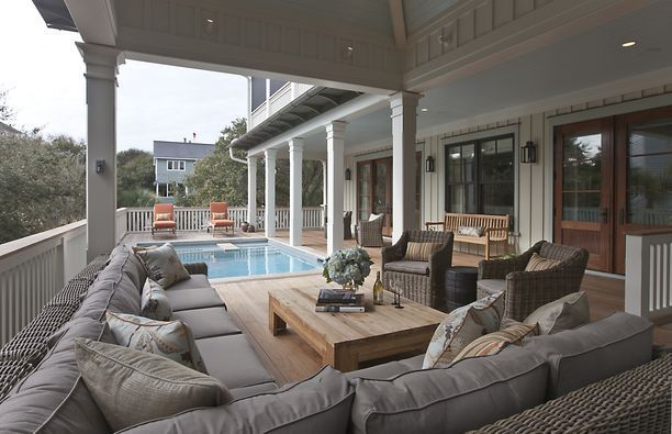 Great big sofa and nice pillars. Add shutters for privacy