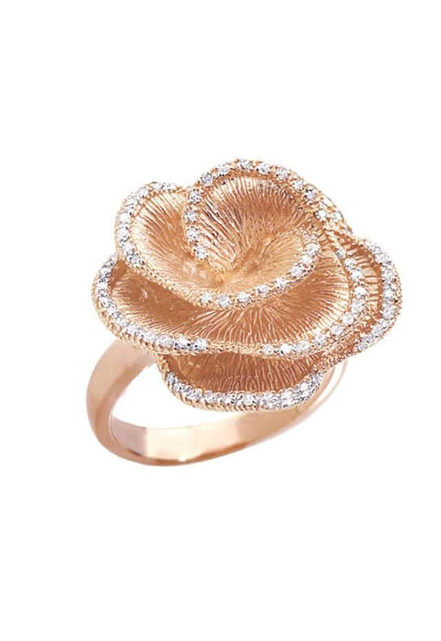 Beautiful diamond ring. I love how the outlining of the petals are lines of diamonds. Nice color, too. :)
