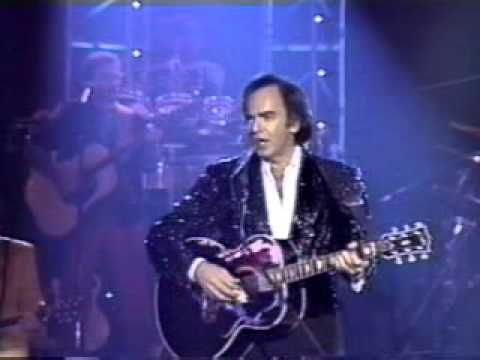 "Neil Diamond - ""I Am, I Said"", amazing live performance!!! This song took Diamond four months to compose. One of his most intensely personal efforts, it depicts the singer lost between two worlds: 'Well, I'm New York City born and raised But nowadays, I'm lost between two shores L.A.'s fine, but it ain't home — New York's home but it ain't mine no more' ..."
