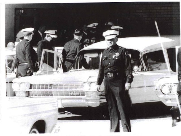The 1964 Cadillac used to transport JFK's body after his assassination  The iconic white hearse that carried the body of President John F. Kennedy after his assassination in 1963 is being put up for auction during a high-profile collectible car sale in Arizona this weekend.  In the hours after John F. Kennedy was assassinated, his body was driven three miles from Parkland Memorial Hospital to Dallas Love Field and Air Force One.