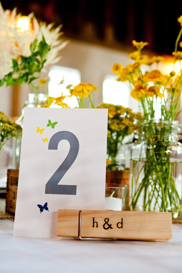 Monogrammed clothespins holding table numbers. Photography By / maweddingphotographers.com, Floral Design By / gilloolydesign.com