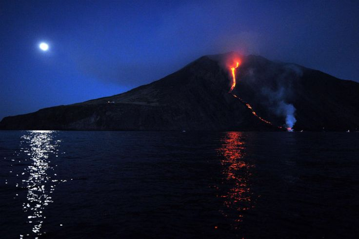 """Lava from the Stromboli volcano flows into the sea. Stromboli, one of Europe's most active volcanoes, is part of the seven-island Eolian Archipelago just off Sicily in southern Italy."" Photo by Giovanni Isolino"