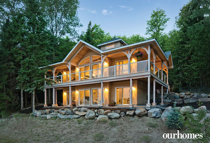 The two-storey lake house boasts plenty of windows and glass doors overlooking the lake. http://www.ourhomes.ca/articles/build/article/lake-peninsula-prize