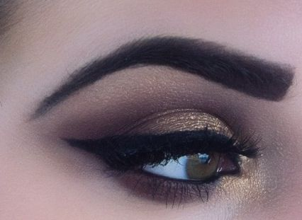 Gold eye makeup, but for my darker skin, I have to make sure my eyebows are a very light brown to pull off this look.