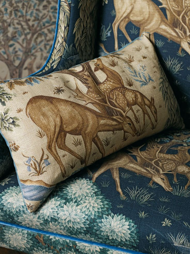 Cushions and chair upholstered in 'The Brook' Tapestry Blue, part of the Archive III Prints by Morris & Co.