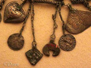 Close up on the lunula and diamond-shaped pendants, Linnaniemi, Hämeenlinna…