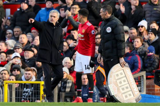 Jose Mourinho the head coach / manager of Manchester United gives instructions to Jesse Lingard as he comes on as a substitute during the Premier...