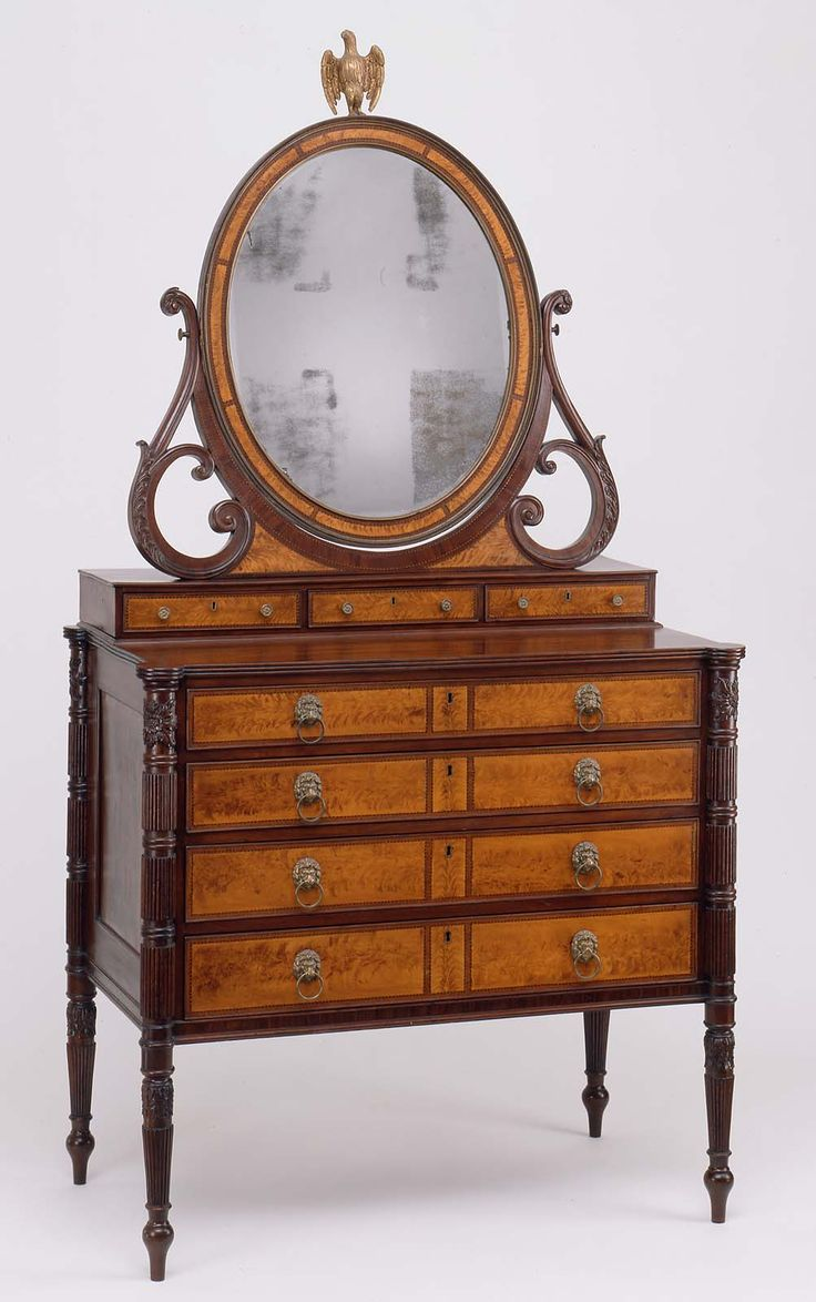 Dressing table with looking glass  about 1809 Attributed to Thomas Seymour (American (born in England), 1771–1848), Probably by James Cogswell (American, 1780–1862), and Possibly John Seymour (American (born in England), 1738–1818), Carving attributed to Thomas Wightman (American, active 1802–1820), Gilder John Doggett (1780–1857)  Object Place: Boston, Massachusetts, United States   Silver plate, cut glass