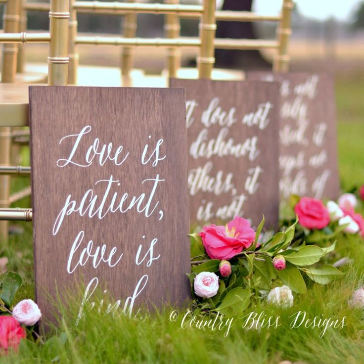 """Love is patient, love is kind"" signs down the aisle.  Sweet idea based on 1 Corinthians 13 verse. By Country Bliss Designs. http://emmalinebride.com/ceremony/love-is-patient-aisle-signs/"