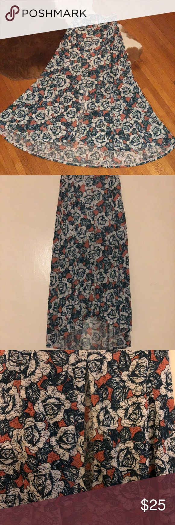 TOPSHOP FLORAL MAXI SKIRT This beautiful high/low maxi is knit from super soft jersey and decked in a beautiful rose print.   Dress it up with an off the shoulder white tee and some wedges or pointed heels to complete the look! Top Shop Skirts High Low