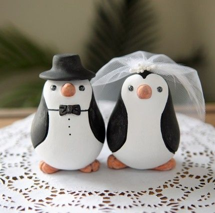 Check out these adorable cake toppers we found on Etsy.com. They start around $80, are individually hand sculpted and painted, and are totally customizable!