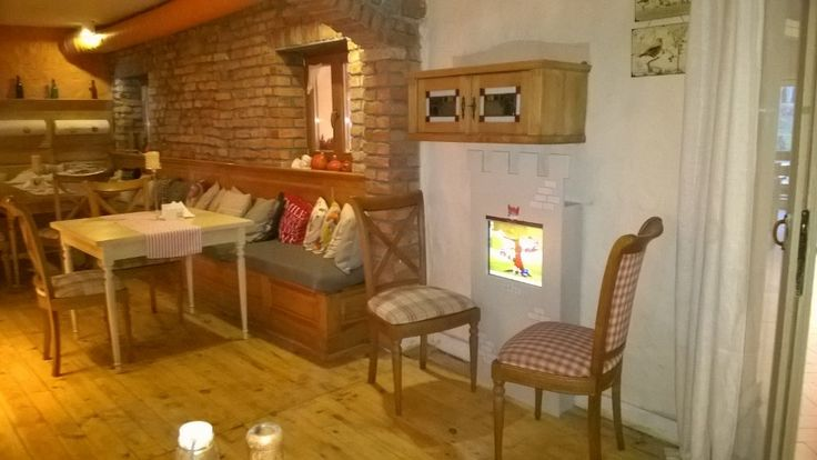 """Interactive kids corner in a cozy and stylish restaurant.  The interactive wall panel """"Tower"""" with plenty of educational games."""