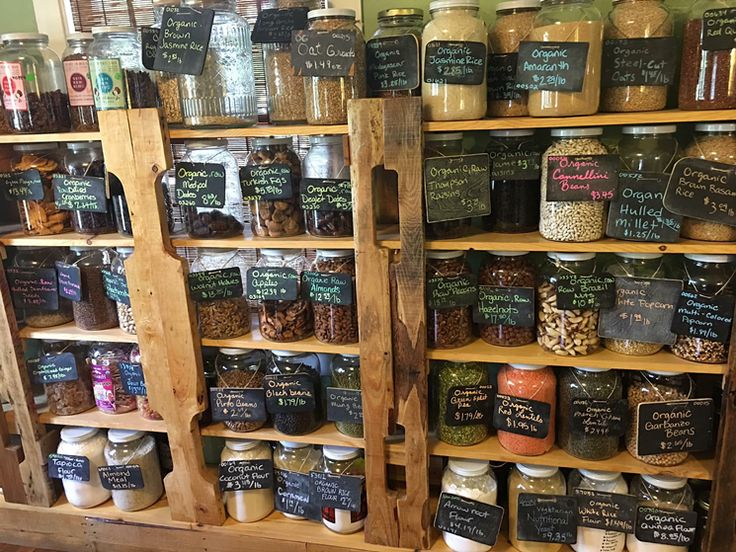 Lining the walls are beautiful glass jars full of dried goods.