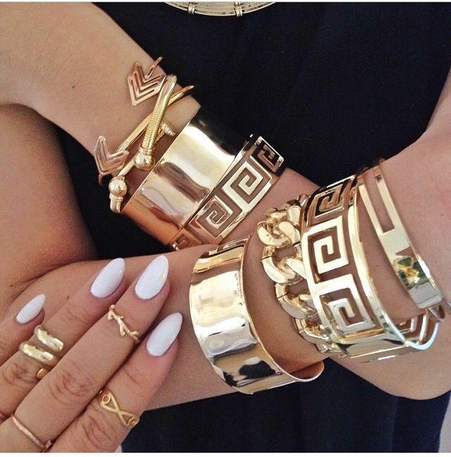Love those Greek key gold bangles...