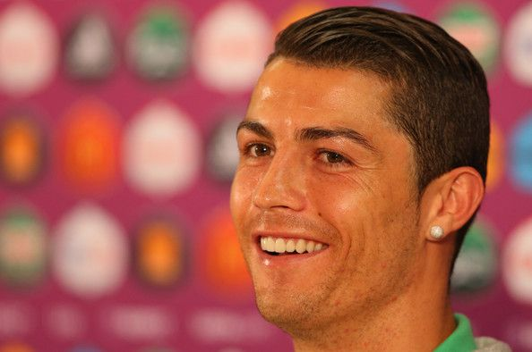 Cristiano Ronaldo Photos Photos - In this handout image provided by UEFA, Cristiano Ronaldo of Portugal talks to the media during a UEFA EURO 2012 press conference at the Arena Lviv on June 8, 2012 in Lviv, Ukraine. - Portugal Training and Press Conference - Group B: UEFA EURO 2012
