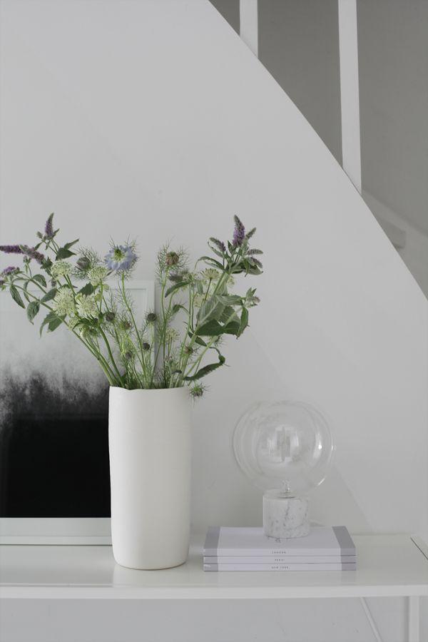 Hallway details, vase by Henrik Rasmussen and &Tradition Marble Lamp. Photo © elisabeth heier